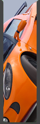side view of an orange Lotus Exige